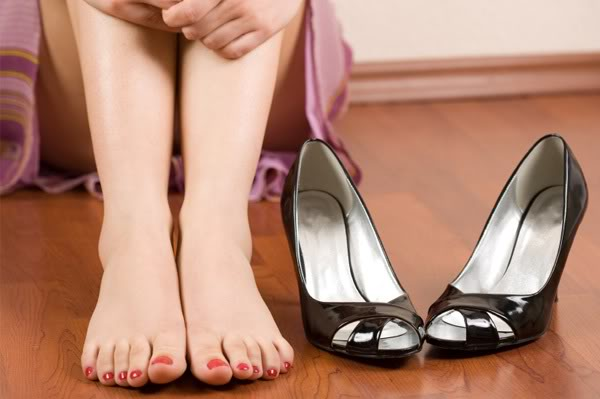 woman-with-tired-feet-with-heels