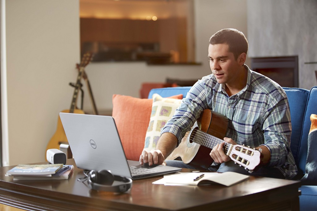 Man Playing Guitar with Inspiron 15 5000 Series Notebook